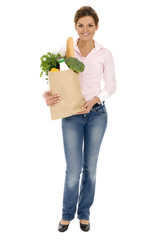 Young woman carrying a grocery bag
