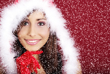 woman wearing sexy santa claus clothes on red background