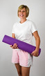 Physically Fit Senior  Boomer Women With Yoga  Polaties Mat