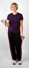 Physically Fit Women Working Out With Resistance Bands