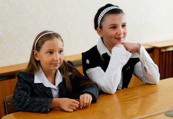 Girls teenagers sit at a lesson
