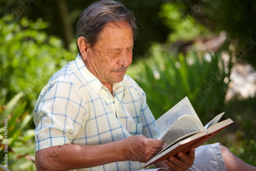 Healthy looking old man is his late 70s sitting in garden