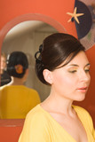 Young woman at the beauty saloon, showing her hairstyle. poster