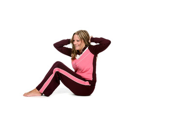 young, pretty woman in pink doing crunches or situps