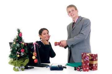 Christmas in the office, businessman and businesswoman