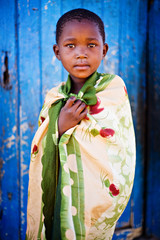 african boy living in a very poor community