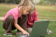 two little girls at laptop