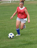 Youth Teen Soccer Player Chasing Ball Down Field poster