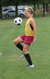 Youth Teen Soccer Player Bouncing Ball in Air poster