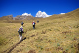 Hikers on trail in high Andes, Yerupaja  in background,