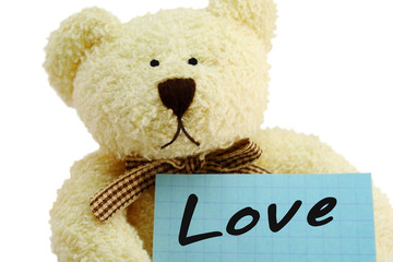 """teddy bear toy with """"Love"""" note, isolated on white"""