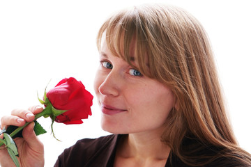 Beautiful young smiling woman with red rose