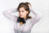 Attractive young lady with earphones poster
