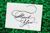 Thank you card on leaf and holly berry background
