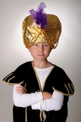 Young boy wearing a Sultan or Shiek's halloween costume.