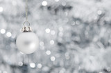 Christmas ball ornament over silver garland background
