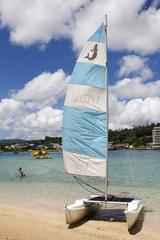 Swimmers and a catamaran in Vanuatu