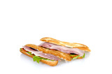 White and brown French bread with ham and cheese, copy-space