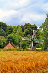 Beautiful scenery of a dutch windmill and farm