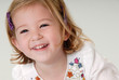 pretty two year old blond girl laughing