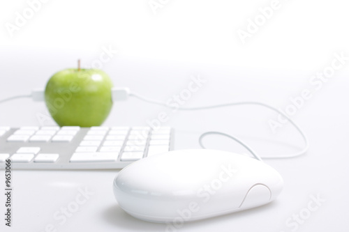 Apple mouse and keyboard on the desk