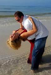 Happy couple having romantic moment on beach