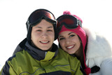 Young happy couple in winter clothes and goggles poster