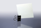Office fastener with sheet paper standing on gray background poster