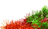 Christmas tinsel of red and green color. Object over white poster