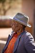 Leinwanddruck Bild - Portrait of elderly  african man with a broken hat