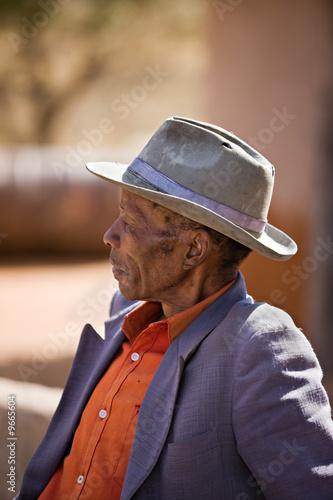 Leinwanddruck Bild Portrait of elderly  african man with a broken hat