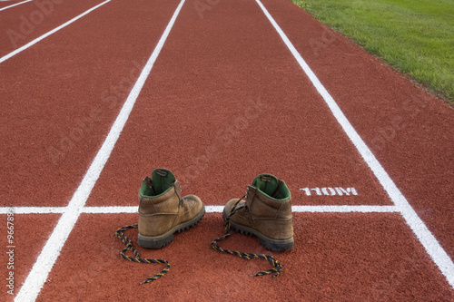 heavy hiking boots on running track - unsuitable equipment