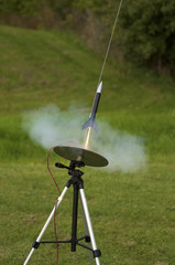 Model rocket launching in a cloud of smoke