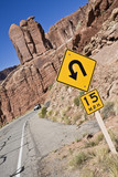 Sharp curve in the mountains - Arches National Park poster