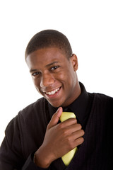 A young black man smiling and holding his yellow tie