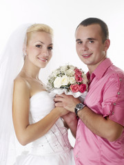 bride and groom holding wedding bouquet together studio shot