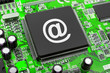 E-mail symbol on computer chip, technology concept