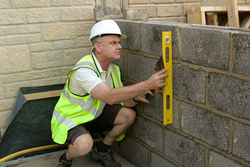 Foreman Checking the wall