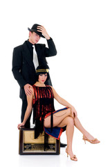 Attractive young couple, retro look with old radio.