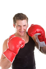 A young boxer with red gloves in a fighing stance