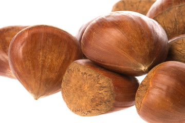 Isolated macro image of raw chestnuts.