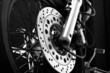 roleta: Closeup detail of a motorcycle front wheel - brake disc