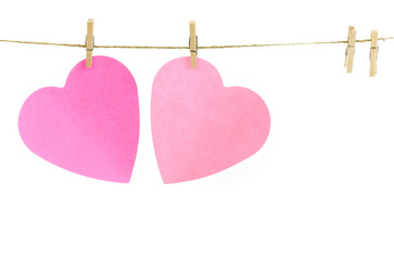 Pink paper hearts on a clothes line.