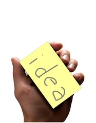 Mand holding a post-it card with the word idea