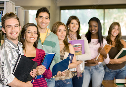 Casual group of college students smiling in the classroom.