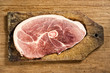 Raw Pork Chop isolated on cutting table.