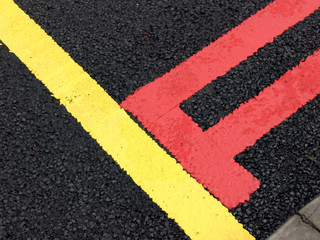 Red and yellow  road lines on new road