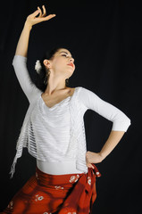 Portrait of young hispanic woman dancing flamenco