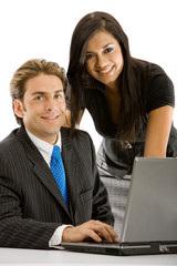 business couple browsing on a laptop - smiling