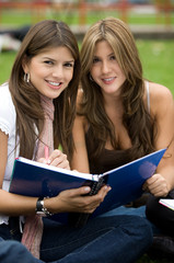 Beautiful girls studying with their notebooks - smiling
